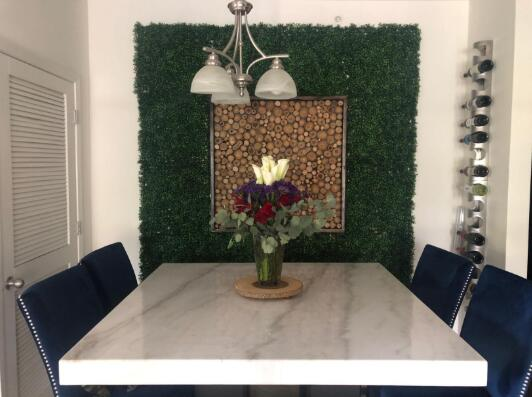 The Artificial Boxwood Makes A Nice Feature Wall